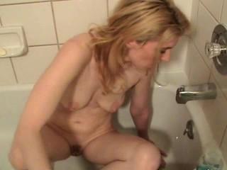 Girl masturbating with bath faucet