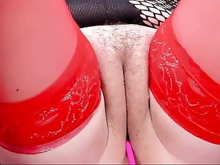 Chubby girl in red stockings shows off her pussy