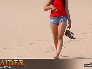 Taking off jeans shorts on the beach
