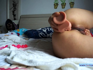 Amateur Asian teen uses several toys and anal beads.