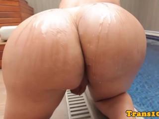 Tanlined latina tranny blowing cock