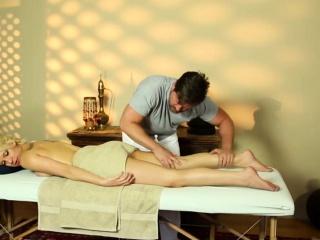 Blonde sprayed by masseur