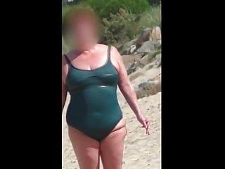 chubby mature in the wet green swimsuit