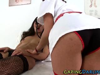 Lez nurse dildo rams ass