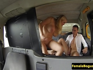 Busty taxi driver doggystyled in cab