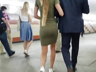 Slim blonde's ass in tight dress