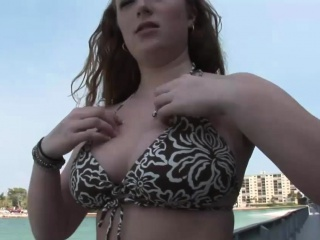 Redhead girl strips down on the beach