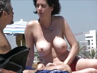 Spying on gorgeous woman on a nudist beach