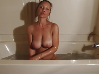 Beautiful brunette big tits taking a bath