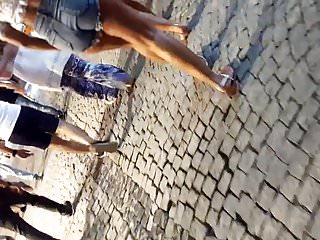 she flashes her perfect ass, cheeks in shorts
