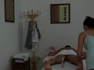 Oriental masseuse sixtynines with her client