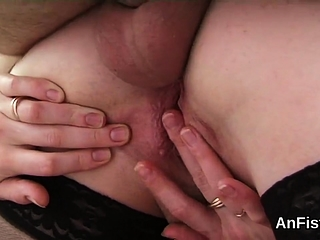 Frisky lesbian beauties are stretching and fist fucking anus