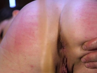 Slave in rope bondage ass caned