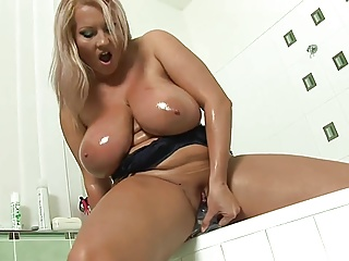 Chubby Milf Plays In The Shower