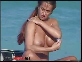 Naked sexy bodies all over this nudist beach are looking hot