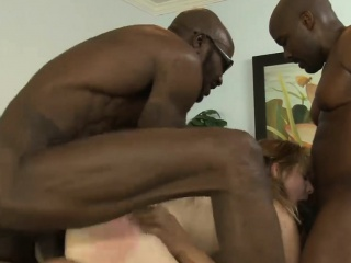 Busty blonde woman dped by big black cocks on the bed