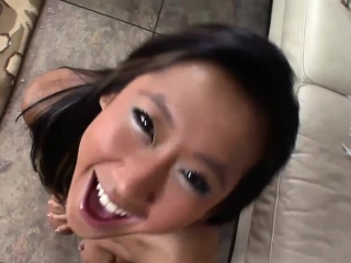 Young Asian babe receives a facial