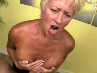 Busty granny titfucks until a warm finish
