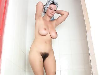 Busty auntie masturbates her bushy twat in the shower