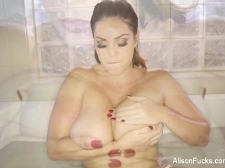 Brunette goddess Alison Tyler plays with herself in the bath