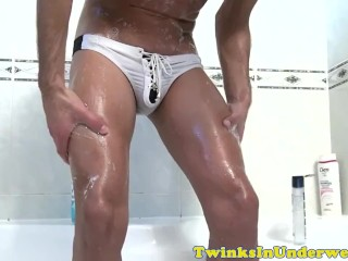 Sporty twink strokes lovers cock during bath