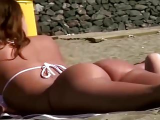 Girl in twenties with a divine butt on the beach