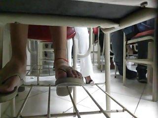 Candid college teen girl feet in flip flops