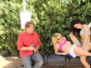 Lesbians tribbing at bus stop in public
