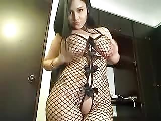 busty posing in bottomless fishnet catsuit