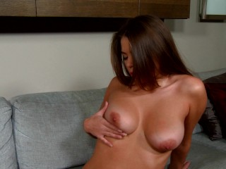 Busty euro strips down and plays with herself