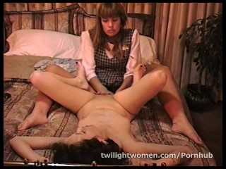 Mistress Cindy's foot fetish brings lesbian sex slave Mara to orgasm
